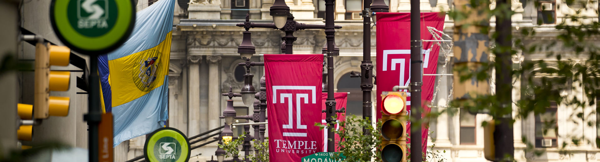 Temple flags amid street signs